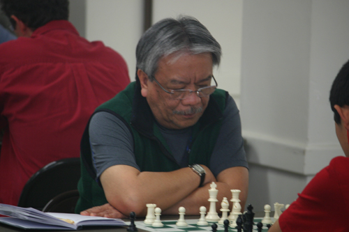 Raoul Crisologo pondering his move against Ryan Chen.