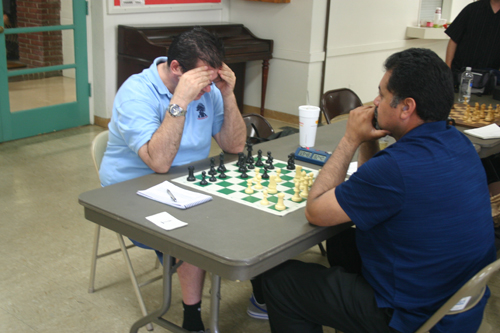 David Bassett (left) deep in concentration against Henry Castro.