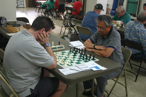 Raoul Crisologo (right) in his decisive game against David Bassett.
