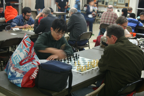Kelly Zhang (left) in his 19 hour game vs Daniel Manahan!